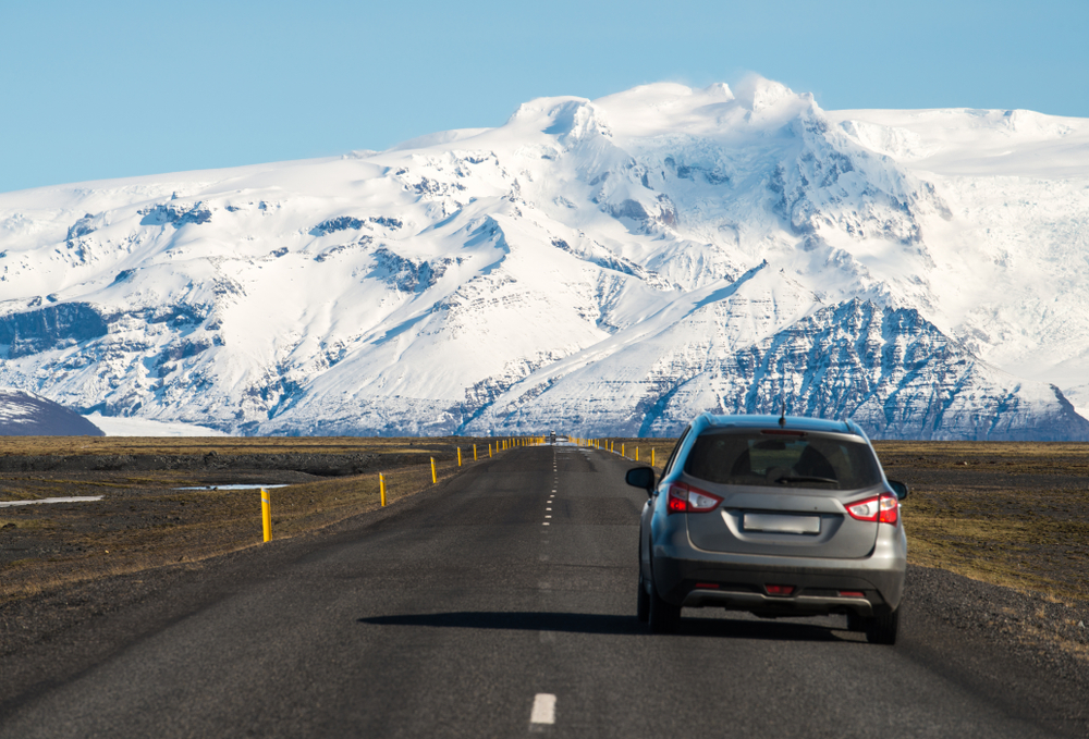 Car driving safely in Iceland along country's Ring Road