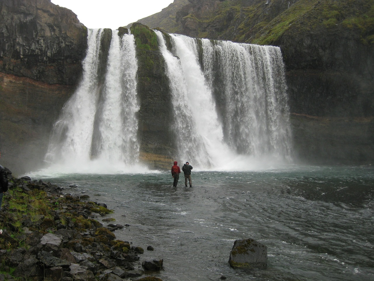 tourists near waterfall in Iceland